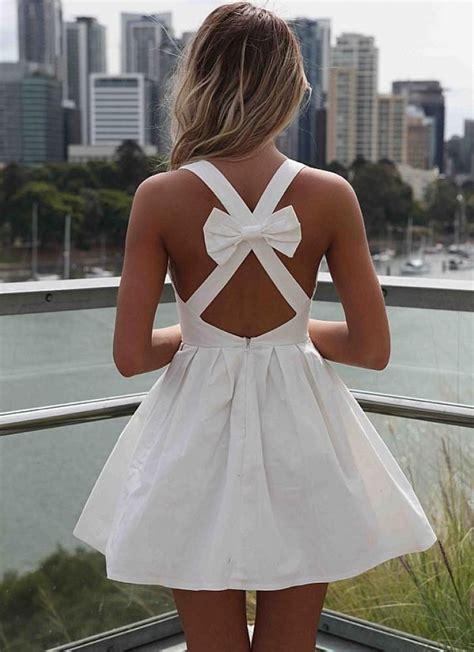 white sleeveless mini dress  open cross bow