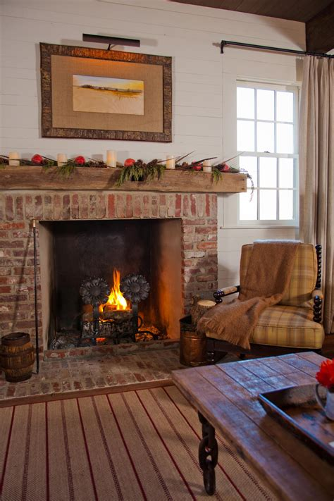 Country Living Room Ideas With Fireplace by Country Living Room With Brick Fireplace And Plaid Chair