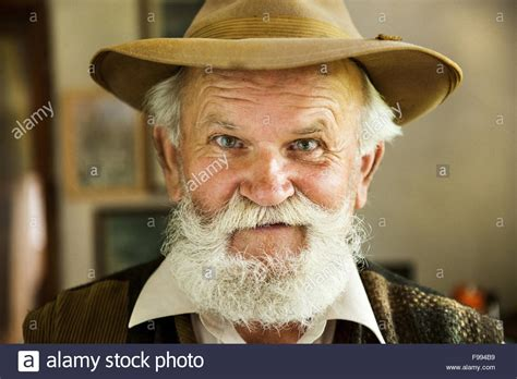 Portrait of old farmer with beard and hat Stock Photo