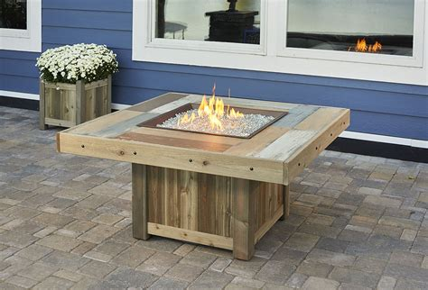 Fire pit tables have gained popularity as more people are bringing indoor living spaces to the outdoors. Vintage Square Gas Fire Pit Table - VNG-2424BRN