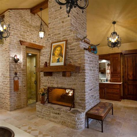 large bathroom features freestanding stone fireplace hgtv