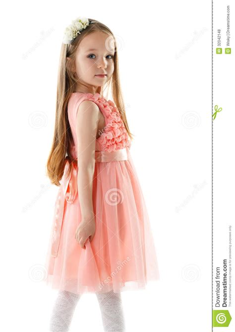 Charming Little Girl In Pink Dress And Rim Stock Photo