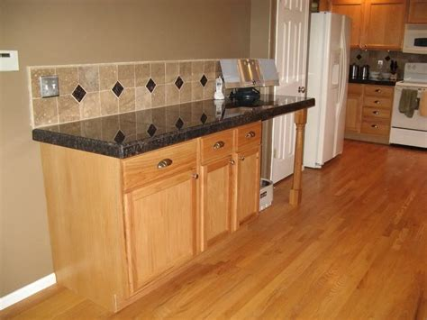 Wooden Kitchen Flooring Ideas by Kitchen Floor Tile Kitchen Tile Floor Sles Design