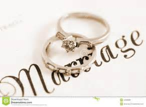 wedding marriage sepia vintage retro style wedding and engagement rings on marriage certificate stock