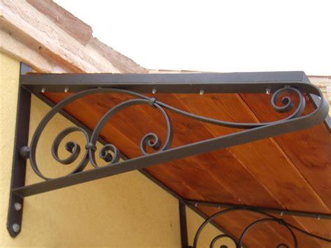 ladari in legno e ferro battuto pensilina ferro battuto