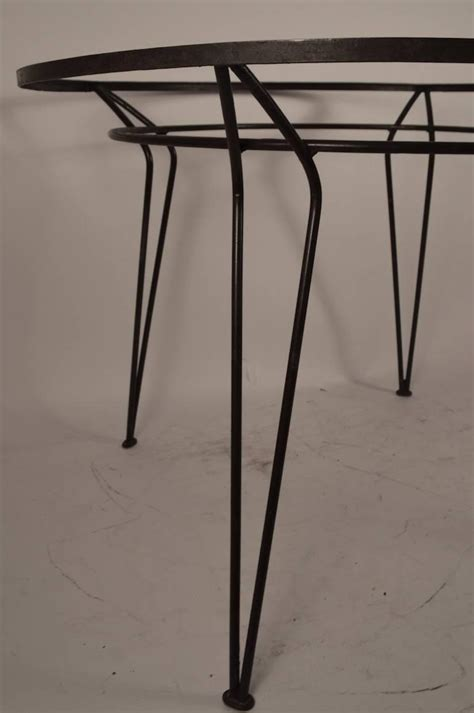 wrought iron and glass dining table wrought iron table with textured glass top after salterini