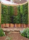 Pershore College show garden. Curved vertical green wall vertical garden institute