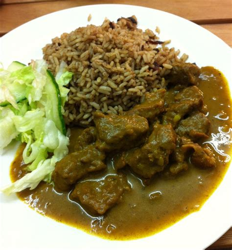 cuisine entree curry goat rice and curries on