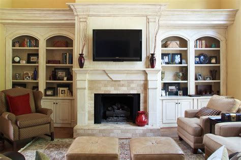 Living Room With Fireplace And Bookshelves by Trantow