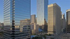 the upper portions of skyscrapers and high rise office With barn builders houston tx