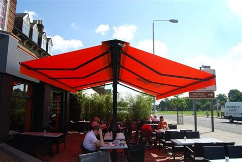 commercial awning  butterfly awning wanstead london belgique cafe alfresco solutions