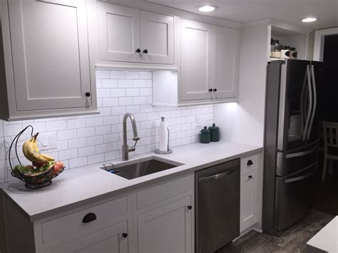 Galley Kitchen With White Shaker Cabinets Subway Tiles