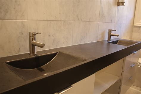 Long Black Bathroom Countertop And Two Shallow Sinks Of