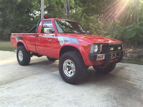 Red Toyota Hilux Pickup Speed Cold
