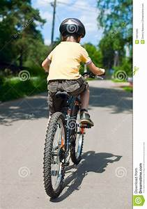 Kid Riding Bicycle Royalty Free Stock Photo - Image: 10015065