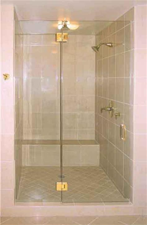 frameless shower enclosure  brass hinges  images