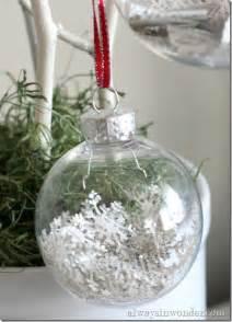 book page confetti inside clear glass ornament