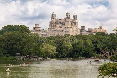 Central Park Boat Paddling by The Lake Central Park And The Beresford New York Editorial