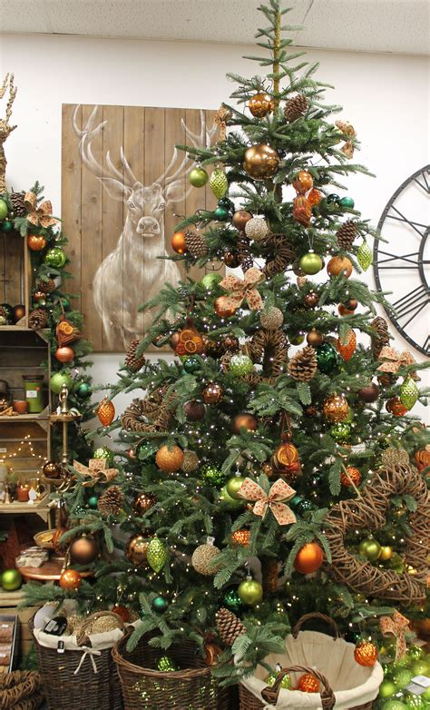christmas decorating with natural elements rustic tree design with pinecones elements burnt orange and green baubles