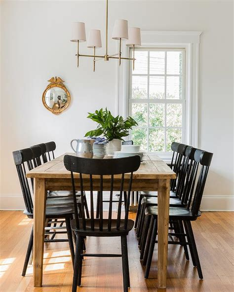 breathtaking farmhouse dining table with black salt chairs