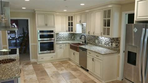pics of kitchens with white cabinets signature pearl kitchen cabinets and santa cecelia granite 9096