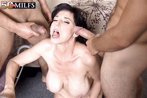 busty brunette milf karen kougar taking double penetration in mmf threesome