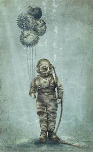 A man in an antique diving suit holds puffer fish as