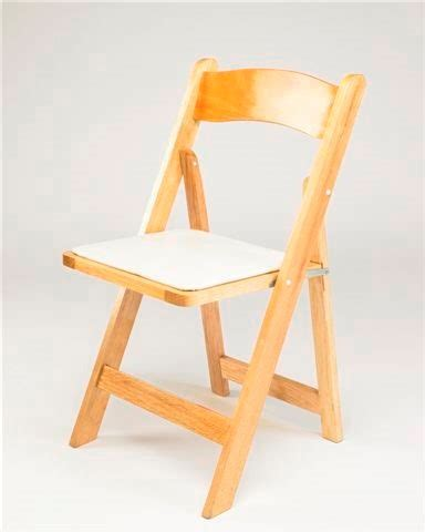 wood folding chair with white cushion eventful