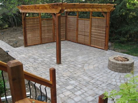 paver patio with firepit and pergola