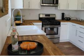 Modern White Cabinets And Acacia Wood Floor Modern Kitchen Los White Kitchen Cabinets With Dark Wood Floors Cottage Kitchen Hardwood Floors In The Kitchen Pros And Cons Designing Idea Stools White Kitchen Island Wooden FLoor WHite Cabinets