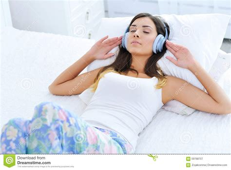 Relaxed Young Woman Listening To Music In Headphones Stock