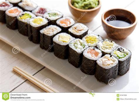 mini table cuisine japanese food mini maki sushi platter on white wooden