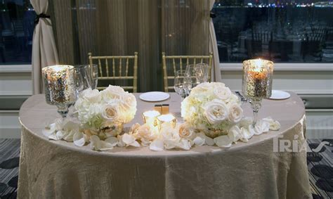 bride and groom table with gorgeous white roses and