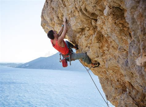 Young Man Struggling Climb Challenging Route Cliff