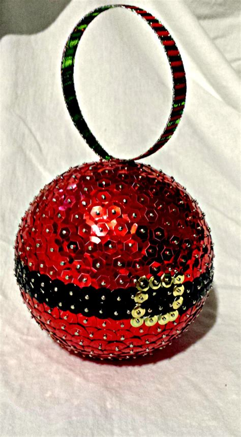 santa claus christmas ornament sequin by stormsleadtorainbows