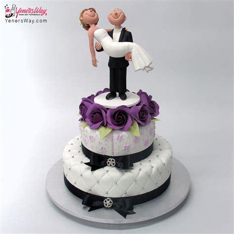 beach theme wedding cake   surfing couple topper