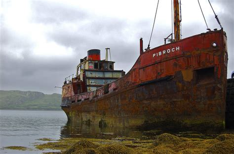 Big Boat In Rust by 48 Eerily Intriguing Shipwrecks