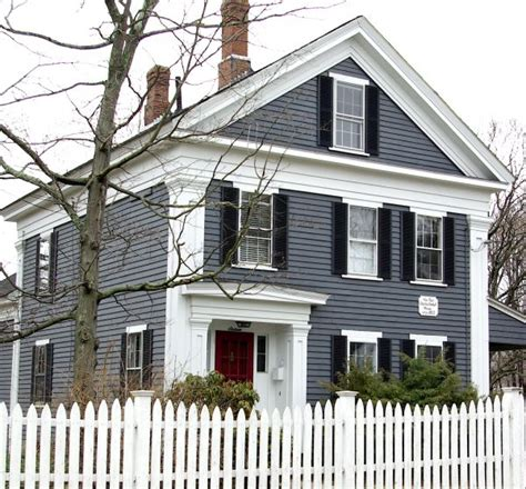 dark gray blue siding white trim red door black shutters white picket fence our home