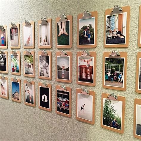 gallery display ideas rows of small clipboards and 5x7 bordered prints is a fun way to show off photos and change them