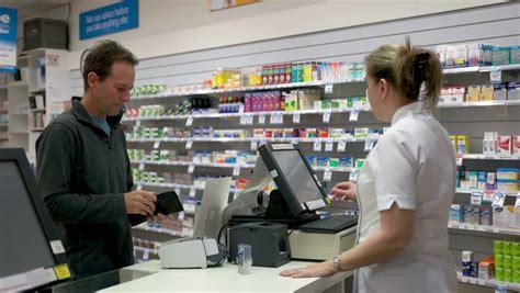 Caremark Pharmacy Help Desk by Hong Kong February 23 2015 Cashier Desk And Computer
