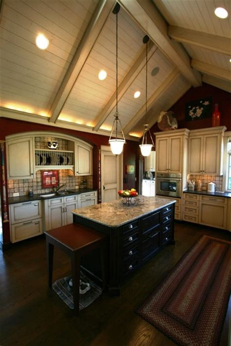 vaulted kitchen ceiling w light wood cabinets
