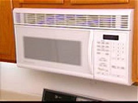 how to hang a microwave under a cabinet tips on buying microwaves diy kitchen design ideas