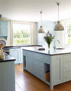 light blue kitchen farmhouse with mixed cabinets