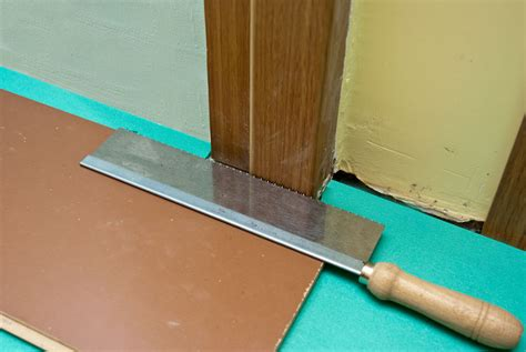 how to lay laminate flooring around doors howtospecialist how to build by diy plans
