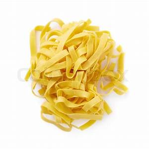 Pile of fresh raw fettuccine ribbon pasta isolated over ...