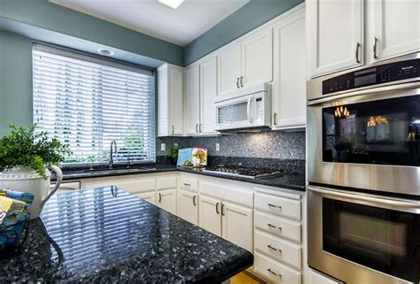 unstained kitchen cabinets 25 best ideas about blue pearl granite on 3069