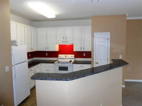 caledonia granite for white cabinets traditional