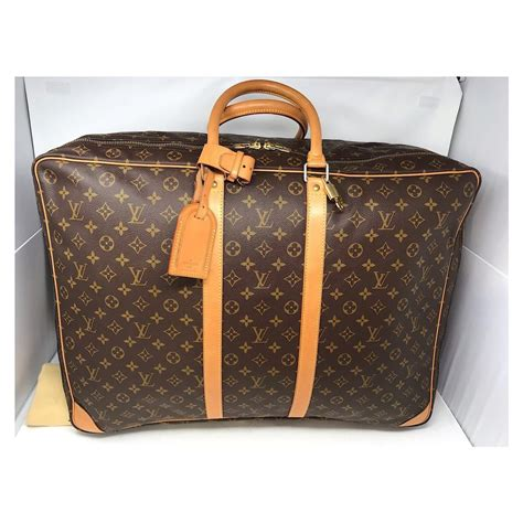 louis vuitton sirius  extra large monogram brown canvas