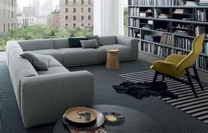 canape gris 50 designs en nuances grises pour votre salon With tapis oriental avec canapé d angle gris scandinave