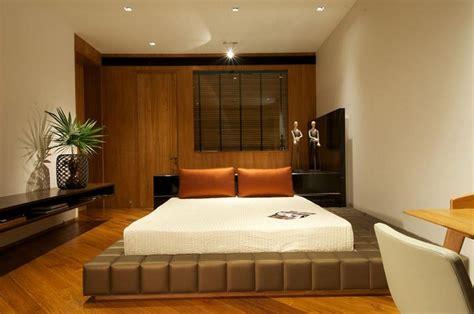 bedroom ideas  cream wall color  laminated wooden floor  brown large platform bed